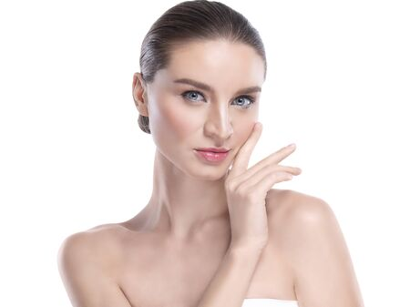 Beauty Young woman with perfect facial skin. Gestures for advertisement treatment spa and cosmetology. Banque d'images - 131956418