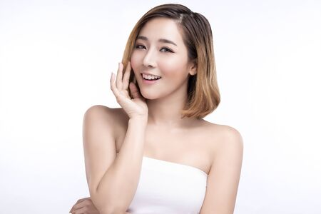 Beauty Young asian woman with perfect facial skin. Gestures for advertisement treatment spa and cosmetology. 免版税图像