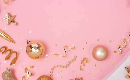 Christmas composition with decorations and gift box with star confetti on pink pastel background. winter, new year concept. Flat lay, top view, copy space.