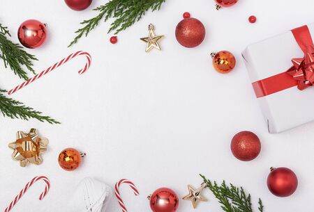 Christmas composition background with decorations and gift box on white background. winter, new year concept. Flat lay, top view, copy space. Banco de Imagens - 134082812