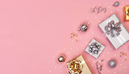 Christmas composition with decorations and gift box with star confetti on pink pastel background. winter, new year concept. Flat lay, top view, copy space. Banco de Imagens - 134082815
