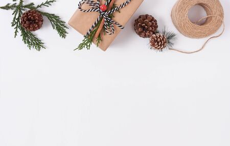 Christmas composition background with decorations and gift box on white background. winter, new year concept. Flat lay, top view, copy space. Banco de Imagens - 134082311