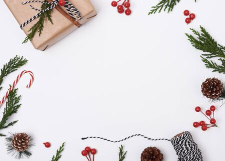 Christmas composition background with decorations and gift box on white background. winter, new year concept. Flat lay, top view, copy space.