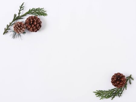 Christmas composition background with decorations pine cone on white background. winter, new year concept. Flat lay, top view, copy space. Banco de Imagens - 134082361