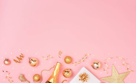 Christmas composition with decorations and gift box with star confetti on pink pastel background. winter, new year concept. Flat lay, top view, copy space. Banco de Imagens - 134082479