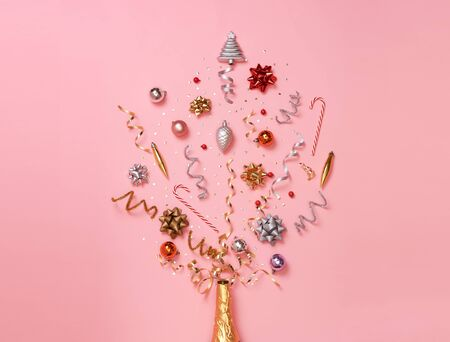 Christmas composition with decorations and ribbon with star confetti on pink pastel background. winter, new year concept. Flat lay, top view, copy space. Banco de Imagens - 134082487