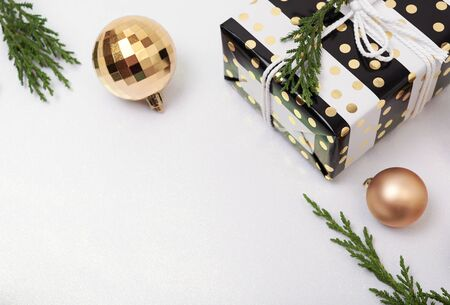 Christmas composition background with decorations and gift box on white background. winter, new year concept. Flat lay, top view, copy space. Banco de Imagens - 134082571