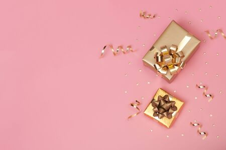 Christmas composition with decorations and gift box with star confetti on pink pastel background. winter, new year concept. Flat lay, top view, copy space. Banco de Imagens - 134082613