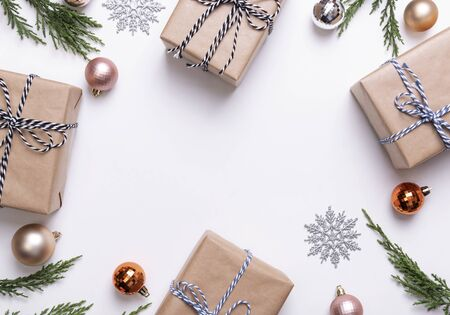 Christmas composition with decorations and gift box with star confetti on white background. winter, new year concept. Flat lay, top view, copy space.