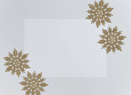 Mock up christmas composition with decorations and snowflake with star on white background. winter, new year concept. Flat lay, top view, copy space Banco de Imagens - 134081819