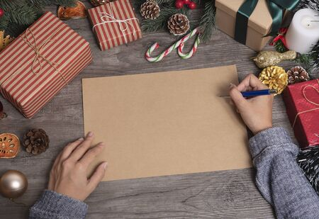 Handwriting mockup greeting card for Merry Christmas and Happy new year with Christmas decoration on wood table.