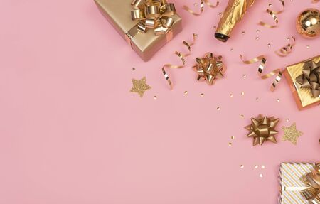 Christmas composition with decorations and gift box with star confetti on pink pastel background. winter, new year concept. Flat lay, top view, copy space. Banco de Imagens - 134082035
