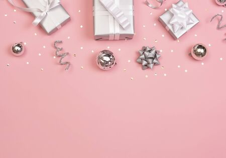 Christmas composition with decorations and gift box with star confetti on pink pastel background. winter, new year concept. Flat lay, top view, copy space. Banco de Imagens - 134082037