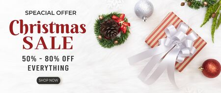 Christmas composition with decorations gift box and merry christmas sale discount text on white background. Stock fotó
