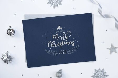 merry christmas greeting paper card on white background with Christmas decorations and confetti.