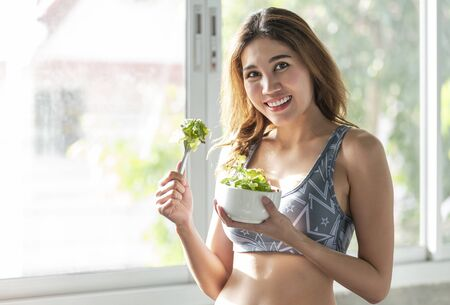 asian woman eating healthy salad. diet health lifestyle concept. Stock Photo