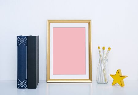 Gold frame mockup with vase and object for interior decoration. Mock up for your photo or text Place your work.