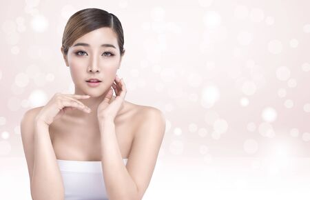 Beauty Young asian woman with perfect facial skin. Gestures for advertisement treatment spa and cosmetology. 스톡 콘텐츠