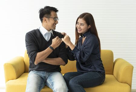 Asian couple lover reconcile two hands hook little finger together to promise.