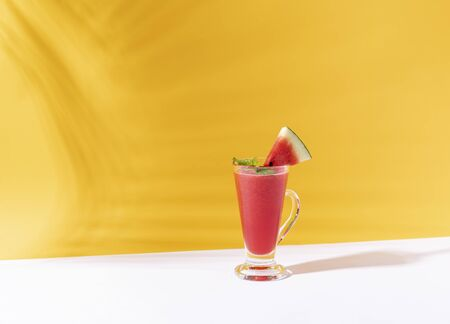 Fresh water melon juice and watermelon slice on color background. summer drink. Stock fotó - 147705023
