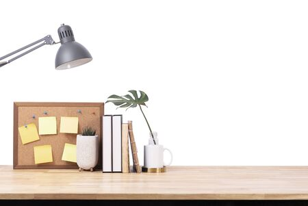 Empty wooden desk space over white background. Product display