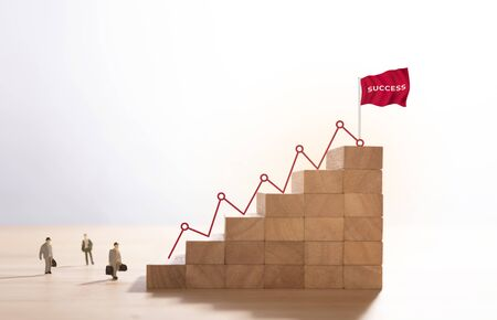 Businessman walking up stairway to the top of wood block mountain, Business concept growth and the path to success. Stock fotó - 147815192