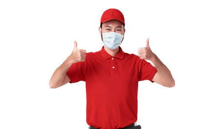 Asian delivery man wearing face mask in red uniform isolated over white background.