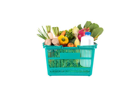 Green plastic grocery basket full of healthy vegetables and fruits,  ingredients isolated on white background. Stockfoto