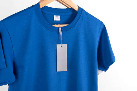 Mockup blank blue t-shirt and blank label tag for advertising.