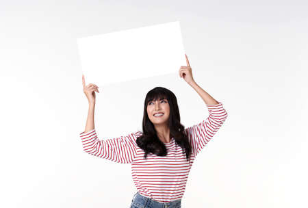 young Asian woman with empty speech bubble studio shot on white background. Stockfoto - 153871496