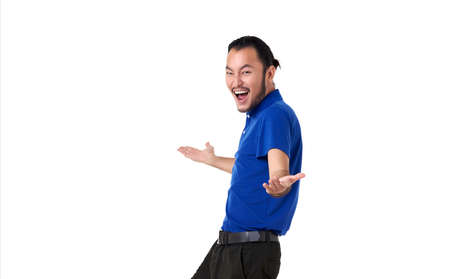 Smile and happy Asian man with open hand gesture present an empty space of content. Advertising model concept.