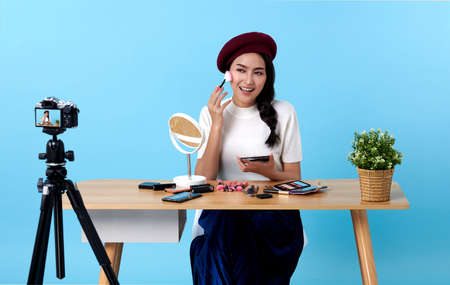 Asian young woman live streaming for beauty vlogger or blogger recording make up tutorial presenting for social people.Her is influencer in social online.