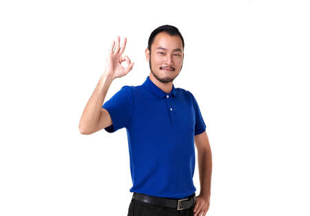 Handsome Asian man is showing an Okay sign gesture. Stockfoto - 154156466
