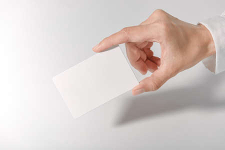 Mockup business card on white background. Template for branding identity and company name.