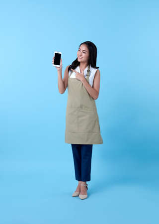 Entrepreneur asian woman using smartphone on blue background.