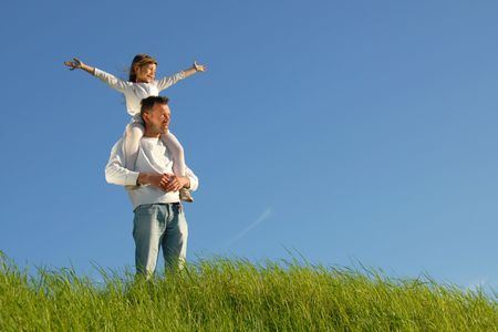 Father gives her daughter piggyback  photo
