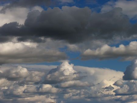 Cloudy sky background, with gray and white clouds with great color contrast