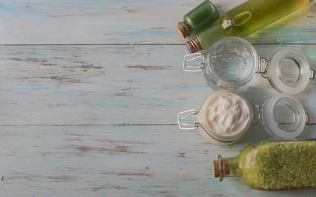 Cream, gel, tonic, bath salts, homemade aloe vera shampoo with pieces of Aloe Vera On a light wooden table, top view Archivio Fotografico