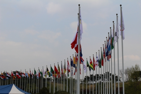 flagpoles: the flags of many nations hang from the flagpoles Stock Photo