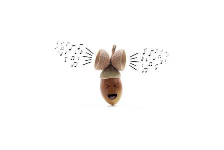 adress: funny oak acorn singing, listening to music and enjoying its own, isolated on white background