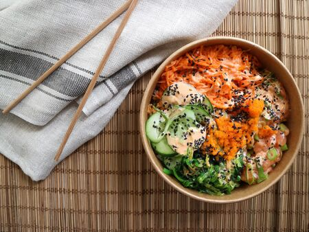 Top view of a salmon poke with chopsticks and a cloth Stok Fotoğraf