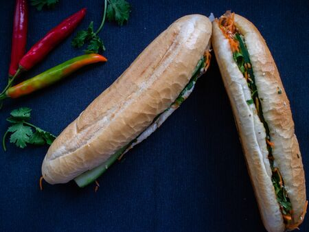 Vietnamese baguette banh mi bo filled with beef, coriander and other vegetables