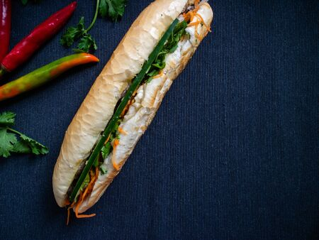 Banh mi bo traditional from Vietnam filled with beef, carrot, coriander and cucumber
