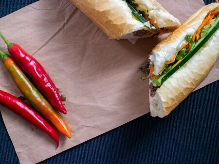 Vietnamse street food banh mi bo on a pepper and decorated with red peppers