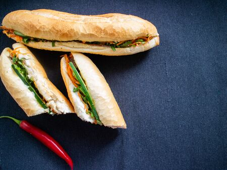 Bahn mi bo cut and banh mi heo nuong on a dark background Stock Photo - 131958042