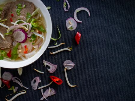 Top view of pho bo with cilantro, peppers and soybeans with copy space Stok Fotoğraf