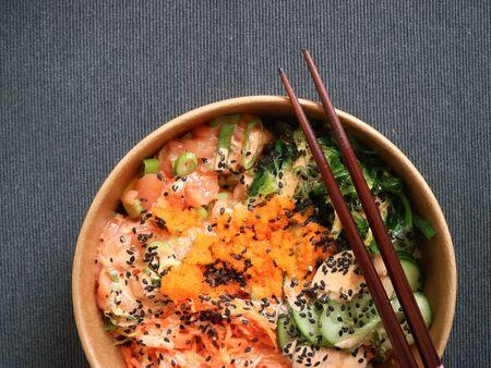 Salmon poke with wakame and spawn Stock Photo