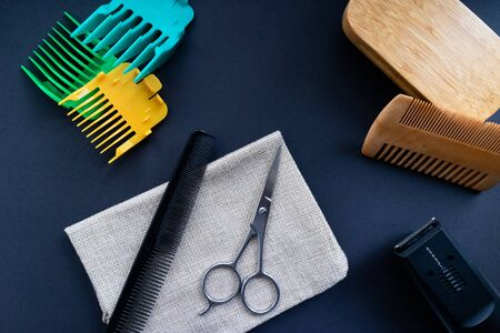 Tools for a trimming your beard. Flat lay with combs, brush, scissors and some colored electric razor heads Stock Photo