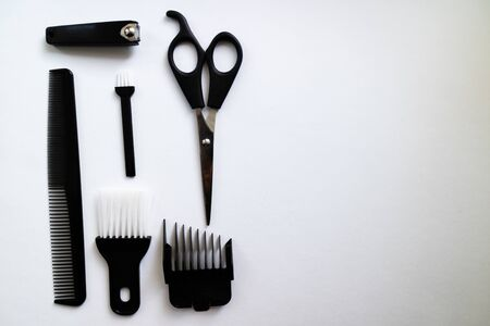 Top view of different tools for trimming a perfect beard. Flat lay on a white background with copy space Stock Photo
