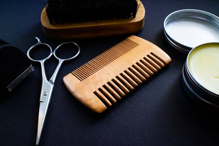 Materials for a perfect beard. Scissor, shaver, comb, wax and brush, all made with natural materials Stock Photo
